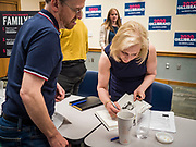 """24 MAY 2019 - WEST DES MOINES, IOWA: US Senator KIRSTEN GILLIBRAND (D-NY), autographs a copy of her book for person who attended her forum in the West Des Moines Public Library. Gillibrand unveiled her """"Family Bill of Rights"""" during a forum in West Des Moines. The New York Senator has made family health and rights a centerpiece of her campaign. She is touring Iowa this week to support her candidacy to be the Democratic nominee for the US Presidency. Iowa traditionally hosts the the first selection event of the presidential election cycle. The Iowa Caucuses will be on Feb. 3, 2020.           PHOTO BY JACK KURTZ"""