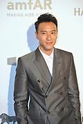 HONG KONG - MARCH 14:  Actor Sunny Wang arrives on the red carpet during the 2015 amfAR Hong Kong gala at Shaw Studios on March 14, 2015 in Hong Kong. Photo : Lucas Schifres/Abaca  (Photo by Lucas Schifres/Lucas Schifres)