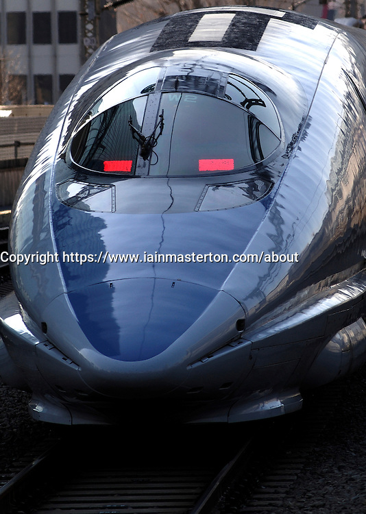 Detail of Japanese bullet train departing from Tokyo Station