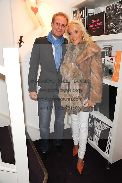 SEBASTIAN & CLARE VAN DAM at a private view of photographs held at the Little Black Gallery, Park Walk, London on 20th January 2010.