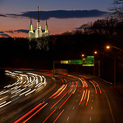 The Washington D.C. Temple, also known as the Mormon Temple, as seen from an I-495 beltway overpass at twilight in Kensington, MD, just outside Washington DC