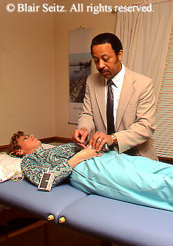 Medical , Acupuncture, African American Acupuncture Therapist and Patient