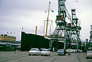 TS Britannia, launched 1929, a Swedish Llloyd ferry ship, at quayside, Norway, cars waiting to be loaded by crane 1966 thought to be Bergen