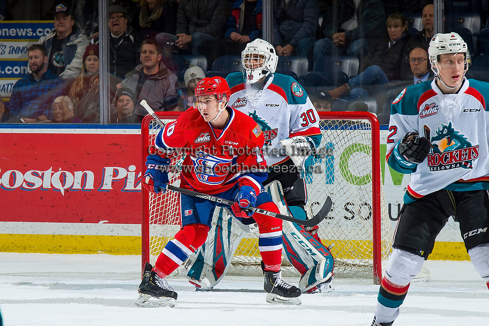 KELOWNA, BC - FEBRUARY 06:  Ethan McIndoe #10 of the Spokane Chiefs looks for the pass ahead of the net of Roman Basran #30 of the Kelowna Rockets  at Prospera Place on February 6, 2019 in Kelowna, Canada. (Photo by Marissa Baecker/Getty Images)