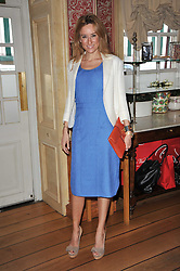 REBECCA KORNER at a lunch hosted by Roger Viver in honour of Bruno Frisoni their creative director, held at Harry's Bar, 26 South Audley Street, London on 31st March 2011.