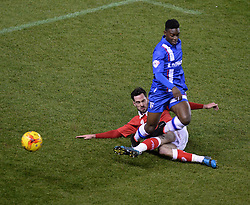 Bristol City's Greg Cunningham tackles Gillingham's Jermaine McGlashan - Photo mandatory by-line: Alex James/JMP - Mobile: 07966 386802 - 29/01/2015 - SPORT - Football - Bristol - Ashton Gate - Bristol City v Gillingham - Johnstone Paint Trophy Southern area final