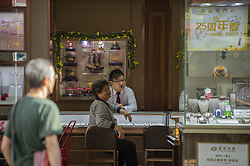 November 21, 2018 - Hong Kong, China - A photo showing a women talking to a clerk in a jewelry shop in Hong Kong, China. 21 November 2018. (Credit Image: © Yuen Wai Lun/NurPhoto via ZUMA Press)