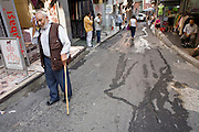 08 AUGUST 2007 -- ISTANBUL, TURKEY: A man walks through the streets of Istanbul, Turkey. Istanbul, a city of about 14 million people, and the largest city in Turkey, straddles the Bosphorus Straits between Europe and Asia. It is one of the oldest cities in the world. It was once the center of the Eastern Roman Empire and was called Constantinople, named after the Roman Emperor Constantine. In 1453, Mehmet the Conqueror, Sultan of the Ottoman Empire, captured the city and made it the center of the Ottoman Turkish Empire until World War I. After the war, the Ottoman Empire was dissolved and modern Turkey created. The capitol was moved to Ankara but Istanbul (formerly Constantinople) has remained the largest, most diverse city in Turkey.    Photo by Jack Kurtz