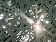 Details of the incredibly intricate metal roof of the Louvre Abu Dhabi, an art and civilization museum designed by famous architect Jean Nouvel.