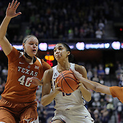 UNCASVILLE, CONNECTICUT- DECEMBER 4: Gabby Williams #15 of the Connecticut Huskies drives to the basket defended by Kelsey Lang #40 of the Texas Longhorns and Brooke McCarty #11 of the Texas Longhorns during the UConn Huskies Vs Texas Longhorns, NCAA Women's Basketball game in the Jimmy V Classic on December 4th, 2016 at the Mohegan Sun Arena, Uncasville, Connecticut. (Photo by Tim Clayton/Corbis via Getty Images)