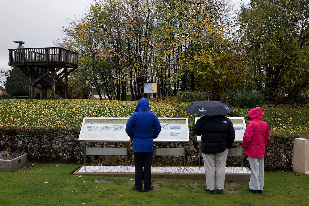 """Visitors near the First Australian Division Memorial in Pozières looking at the information panels that explain the sites, on the back under the trees  is the """"Gibraltar Blockhouse"""" and the viewing platform with great views over the WWI battlefields. The Battle of Pozières was a two week struggle (23 July – 7 August 1916) by British and Australian divisions for the capture of the village of Pozieres during  the 1916 battle of the Somme."""