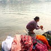 Woman washing clothes at Hanuman ghat