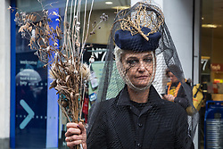 London, UK. 12 October, 2019. A climate activist from Extinction Rebellion dressed in black and wearing a veil takes part in the XR funeral march from Marble Arch to Russell Square on the sixth day of International Rebellion protests to demand a government declaration of a climate and ecological emergency, a commitment to halting biodiversity loss and net zero carbon emissions by 2025 and for the government to create and be led by the decisions of a Citizens' Assembly on climate and ecological justice. Credit: Mark Kerrison/Alamy Live News