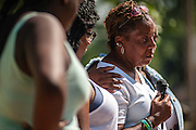 MILWAUKEE, WI -- 8/11/15 -- Yolander (cq) Surveyor, 51 speaks at the dedication of Tracolli Peace Park. Named after her son, Tracolli Surveyor, gunned down December 10, 2014 a block from his house as he walked a family friend home from school. The park was dedicated to peace in his memory. Tracolli was set to graduate this spring and was to attend Ivy Tech in Indianapolis to study graphic designMilwaukee leads the nation in most negative indicators of African-American social problems: educational achievement gaps, incarceration rates, unemployment and segregation.…by André Chung #_AC12937
