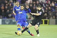 AFC Wimbledon midfielder Tom Soares (19) tackling Wigan Athletic midfielder Sam Morsy (5) during the EFL Sky Bet League 1 match between AFC Wimbledon and Wigan Athletic at the Cherry Red Records Stadium, Kingston, England on 16 December 2017. Photo by Matthew Redman.