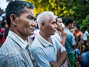 17 JUNE 2015 - YAHA, YALA, THAILAND: Thai Muslim men look for the crescent moon during the Hilal in Yaha, Thailand. Thousands of people came to Yaha District in Yala province of Thailand for the Hilal - the first sighting of the crescent moon that marks the official beginning of the Muslim holy month of Ramadan. Despite cloudy weather and intermittent rain showers, the moon was sighted and religious leaders declared the official beginning of Ramadan.    PHOTO BY JACK KURTZ
