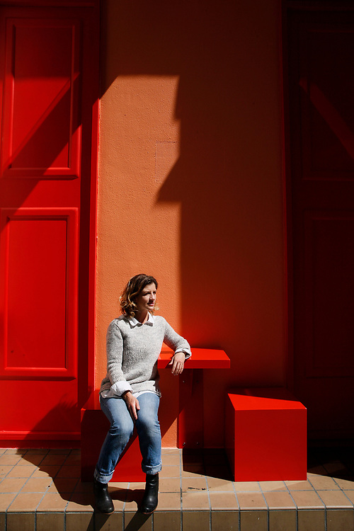 """Leah Rosenberg, the artist behind the new Sites Unseen """"Local Color"""" sits for a portrait at her public art installation located at Natoma Street and New Montgomery Street on Saturday, July 29, 2017, in San Francisco, Calif."""