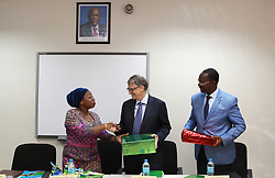 August 10, 2017 - Dar Es Salaam, Dar es Salaam, Tanzania - Bill Gates, American business magnate and philanthropist, announced a 5 million investment that will digitize Tanzania's health information systems to improve health data in the country. He congratulated the government of Tanzania on their leadership and drive to incorporate digital health and data into their policy framework. Dr. Ummy Mwalimu, Minister of Health, left, and George Simbachawene, Minister of President's Office, present Gates with gifts. (Credit Image: © Ric Francis via ZUMA Wire)
