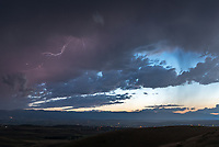 I had been wanting to shoot a storm rolling out of the mountains from this overlook next to I-90. But this particular storm was dying just after sunset and produced hardly any lightning.