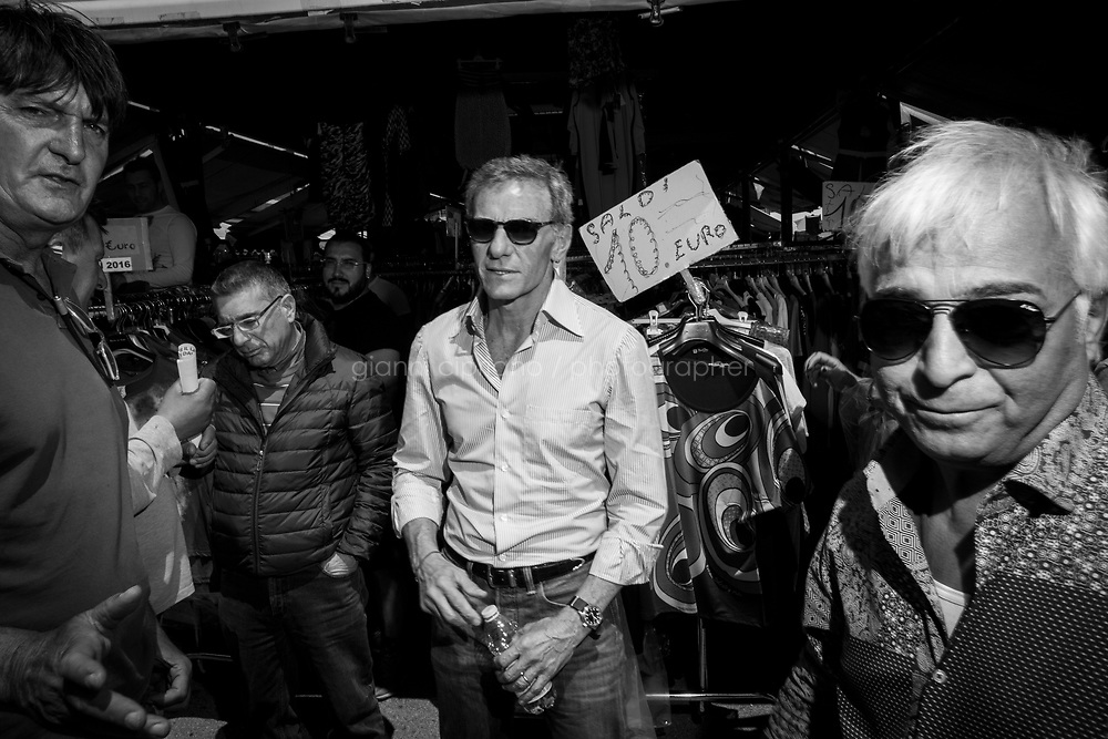 NAPLES, ITALY - 8 MAY 2016: Gianni Lettieri, running for mayor in  the 2016 city elections, visits a clothes market in Poggioreale, Naples, Italy, on May 1st 2016