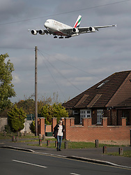 """© Licensed to London News Pictures. 27/10/2016. London, UK. An Emirates A380 Airbus comes into land at Heathrow Airport. The government has announced that a third runway will be built at the United Kingdom's busiest airport. The Cabinet are divided - with Foreign Secretary Boris Johnson saying that the project is """"undeliverable"""". Conservative MP for Richmond Zac Goldsmith has resigned. Photo credit: Peter Macdiarmid/LNP"""