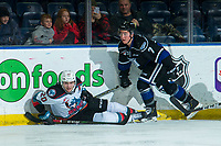 KELOWNA, BC - JANUARY 3:  Matthew Wedman #20 of the Kelowna Rockets falls to the ice after a check by Noah Lamb #7 of the Victoria Royals in second period at Prospera Place on January 3, 2020 in Kelowna, Canada. (Photo by Marissa Baecker/Shoot the Breeze)