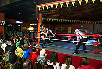 A packed house watches Marcus Burke getting slammed into the corner by Robbie L during Pro Wrestling Injustice for Brawl at the Whiskey Barrel Saturday evening to benefit PJ Kearney and the Boston Children's Hospital.  (Karen Bobotas/for the Laconia Daily Sun)