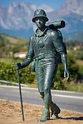 Hiker bronze statue on Pilgrim's Way at Potes in Picos de Europa, Asturias, Northern Spain