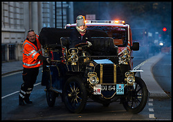 November 6, 2016 - London, London, United Kingdom - Image ©Licensed to i-Images Picture Agency. 06/11/2016. London, United Kingdom. ..The London to Brighton Veteran Car Run 2016...The driver of a 1904 Gladiator Side-entrance Tonneau is assisted by The RAC after encountering mechanical problems passing through Parliament Square, Westminster, in central London, UK, on the first leg of the journey from London to Brighton...Picture by Ben Stevens / i-Images (Credit Image: © Ben Stevens/i-Images via ZUMA Wire)
