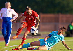 NEWPORT, WALES - Tuesday, June 12, 2018: Wales' Jessica Fishlock (left) is tackled by Russia's captain Anna Kozhnikova during the FIFA Women's World Cup 2019 Qualifying Round Group 1 match between Wales and Russia at Newport Stadium. (Pic by David Rawcliffe/Propaganda)