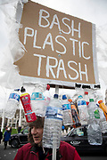 Anti plastics protester stands in the street in Westminster demonstrating against the overuse of plastic in society and calling for a ban in London, United Kingdom.