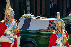 The Duke of Edinburgh's coffin, covered with his Personal Standard, arrives on a Land Rover Defender outside St George's Chapel, Windsor Castle, Berkshire, ahead of his funeral. Picture date: Saturday April 17, 2021.