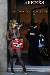 London, UK. 8th September, 2021. A PETA supporter wearing a Venetian crocodile mask poses outside the Hermès store in New Bond Street in protest against the luxury fashion house's use of exotic skins. PETA's campaign was launched following the release of video footage by The Kindness Project showing crocodiles being mutilated, electrocuted, stabbed and shot on farms in Australia with ties to Hermès and PETA are calling on the fashion brand to cease using exotic skins for their products.