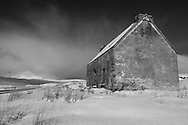 """A derelict house at Fainmore on """"Desolation Pass"""" alongside the Dundonnell Rover near Ullapool, Scotland."""