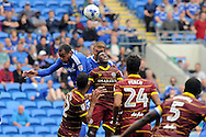 Cardiff City's Kenneth Zohore (l) and Emyr Huws (c) are challenged by QPR's Yeni Ngbakoto (c). EFL Skybet championship match, Cardiff city v Queens Park Rangers at the Cardiff city stadium in Cardiff, South Wales on Sunday 14th August 2016.<br /> pic by Carl Robertson, Andrew Orchard sports photography.
