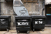 Dustbins outside the back of restaurants in Chinatown in London, UK.