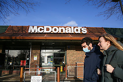 © Licensed to London News Pictures. 14/12/2020. London, UK. A couple walk past McDonald's in north London. Health officials are concerned about a sharp rise in coronavirus infection rates in London which means the capital may go into tier three tougher lockdown restrictions. In tier three, bars, pubs, cafes and restaurants, including McDonald's must stay closed, except for delivery and takeaway. Photo credit: Dinendra Haria/LNP