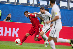 ST. PETERSBURG, June 18, 2017  Fedor Smolov (L) of Russia vies with Ryan Thomas of New Zealand during the group A match between Russia and New Zealand of the 2017 FIFA Confederations Cup in St. Petersburg, Russia, on June 17, 2017. Russia won 2-0. (Credit Image: © Bai Xuefei/Xinhua via ZUMA Wire)