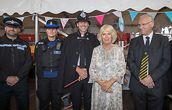 The Duchess of Cornwall poses for a photograph at Newquay Fire Station as she meets with residents from Tregunnel Hill, Cornwall, a mixed-use neighbourhood built on Duchy of Cornwall land in Newquay comprising open-market and affordable homes.