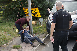 © Licensed to London News Pictures. 29/09/2021. Swanley, UK. An angry motorist drags away an activist from the Insulate Britain climate change protest group as they block the road near to junction 3 of the M25 motorway near Swanley for the second time today. 11 members of the campaign group were detained at the same junction earlier today. This is the seventh time in just over two weeks that activists have disrupted traffic on London's orbital motorway despite the government being granted a temporary High Court Injucntion banning the group from protesting on the M25. 50 protesters who were detained after Monday's protest, on junction 14 of the M25 at Heathrow, were released. Photo credit: Peter Macdiarmid/LNP