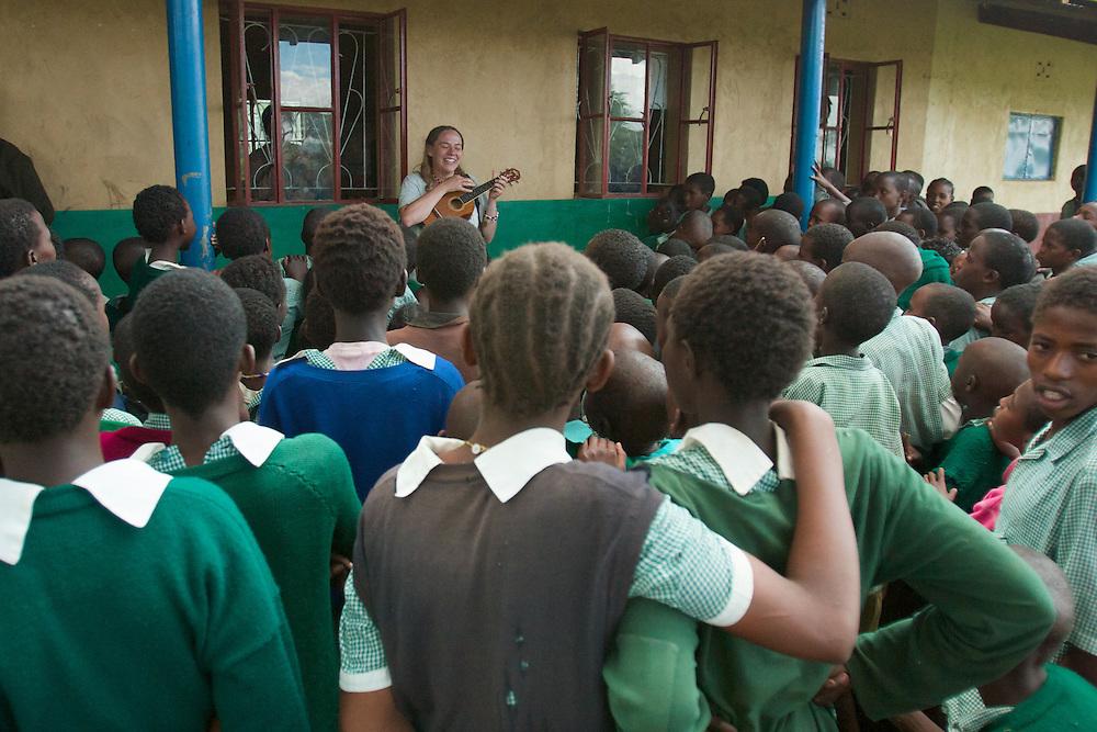 Mindy plays her ukulele for a crowd of school children at Wamba CCM Primary School, Samburu District, Kenya.