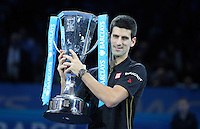 Novak Djokovic (SRB) poses with the trophy after Roger Federer (SUI) withdrew from their in their Singles Final match due to injury<br /> <br /> Photographer Kieran Galvin/CameraSport<br /> <br /> International Tennis - Barclays ATP World Tour Finals - O2 Arena - London - Day 8 - Sunday 16th November 2014<br /> <br /> © CameraSport - 43 Linden Ave. Countesthorpe. Leicester. England. LE8 5PG - Tel: +44 (0) 116 277 4147 - admin@camerasport.com - www.camerasport.com