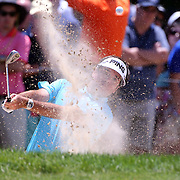 Bubba Watson, USA, chips out of the bunker on the 5th hole during the final round of the Travelers Championship at the TPC River Highlands, Cromwell, Connecticut, USA. 22nd June 2014. Photo Tim Clayton