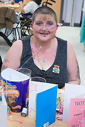 Woman; who has severe asthma; celebrating her fortieth Birthday at a party,