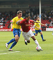 Photo: Mark Stephenson.<br />Walsall v Hereford United. Coca Cola League 2. 09/04/2007. Walsall's Chris Westwood (R) wins the ball from Hereford's Danny Thomas