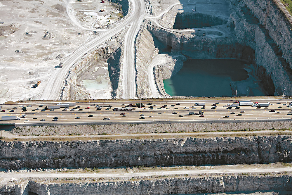 A highway passes over Thornton Quarry, the largest limestone quarry in the world.