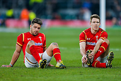 Wales replacement Rhys Webb and Full Back Liam Williams look dejected after England hang on to win the match 25-21 to lift the Triple Crown having beaten Scotland, Ireland and Wales in the 6 Nations - Mandatory byline: Rogan Thomson/JMP - 12/03/2016 - RUGBY UNION - Twickenham Stadium - London, England - England v Wales - RBS 6 Nations 2016.