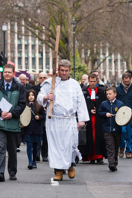 Hundreds of Christians in London take part in the interdenominational Methodist, Anglican and Catholic March of Witness in Westminster. PICTURED: The cross is borne towards Westminster Cathedral