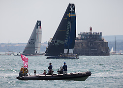 © Licensed to London News Pictures. 22/07/2016. Portsmouth, United Kingdom.  America's Cup team Groupama (FRA) and Artemis (SWE) in a practice race for the America's Cup World Series (ACWS) in Portsmouth this weekend, 22nd-24th July 2016. British Olympic sailing legend, Sir Ben Ainslie, is leading his all-British team, Land Rover BAR, against other teams in a battle to qualify for a place in the two team America's Cup final, to be held in Bermuda in 2017. Today (22/07/16) is a practice day, followed by two days of racing. Photo credit: Rob Arnold/LNP