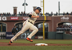 April 30, 2018 - San Francisco, CA, U.S. - SAN FRANCISCO, CA - APRIL 30: San Francisco Giants Catcher Buster Posey (28) tags third as he head home during the San Francisco Giants and San Diego Padres game on April 30, 2018 at AT&T Park in San Francisco, CA. (Photo by Stephen Hopson/Icon Sportswire) (Credit Image: © Stephen Hopson/Icon SMI via ZUMA Press)